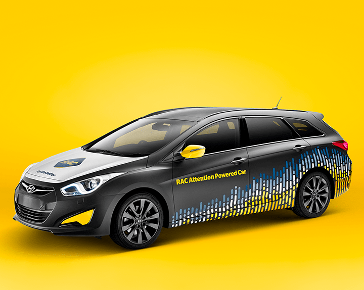 Rendering of a car with RAC Attention powered car written on side