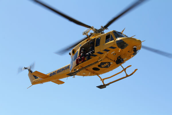 An RAC Rescue helicopter flying through the sky