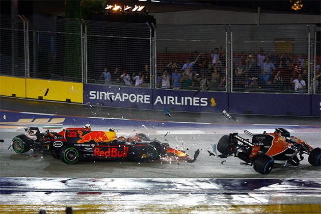 Racecar driver Daniel Ricciardo in a crash during a race