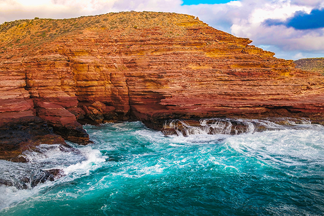 Red cliffs against ocean