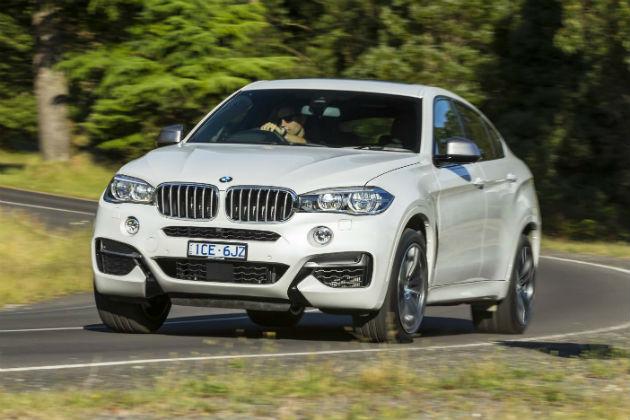 Driving white BMW x6