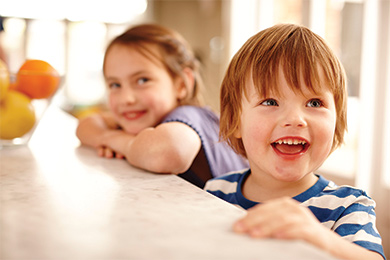 Kids smiling in their family home