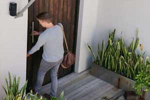 man walks into house