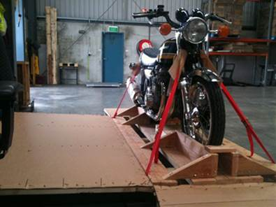 a motorbike in a box pre-flight