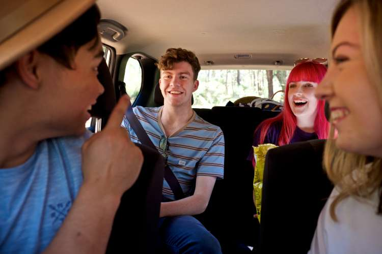Teens in car together