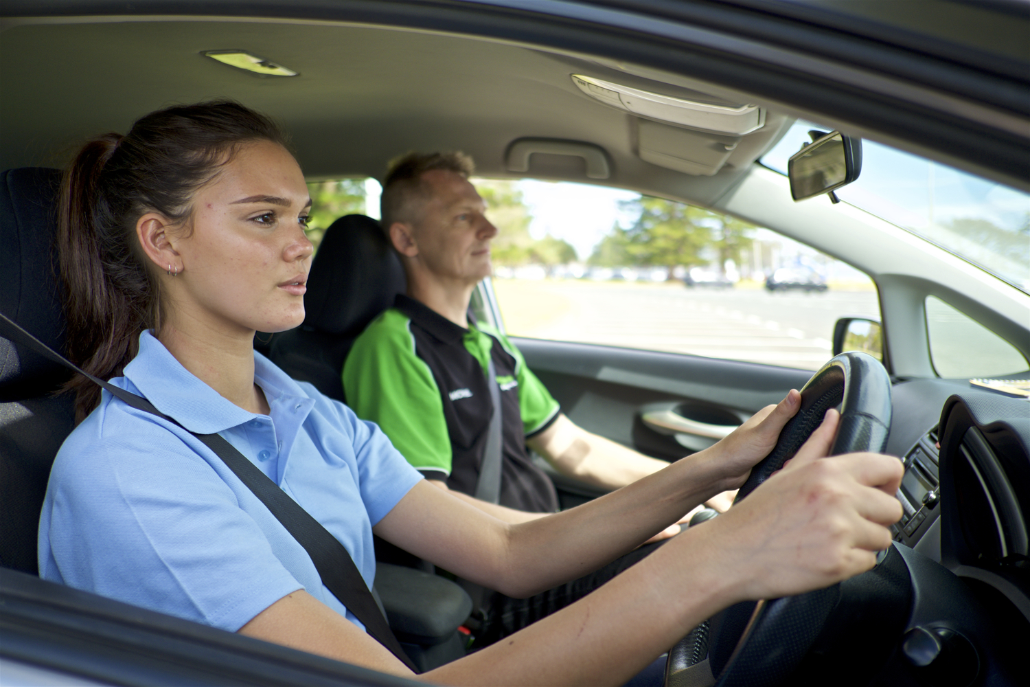 Driving instructor and student in car